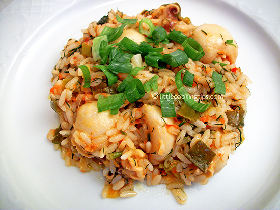 Delicious cuttlefish with rice and spring onions