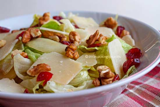 Crunchy and sweet salad with iceberg, cranberries and parmesan