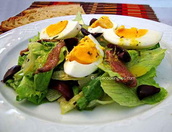 Lettuce salad with eggs, kalamata olives and anchovies