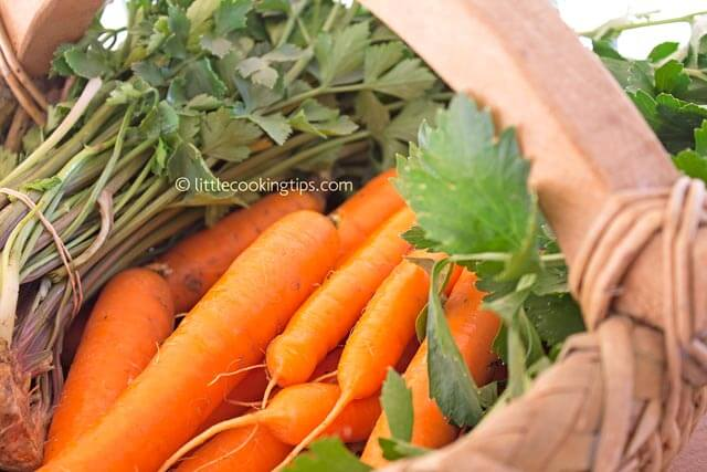 Carrots and fresh celery in a basket