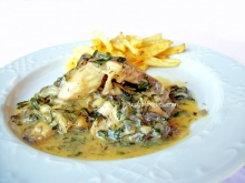 Fish fillet on egg-lemon sauce