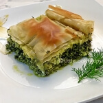 Traditional Greek pie with arugula, ricotta (anthotyros) and greens