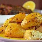 Traditional Greek Lemon Garlic Roasted Potatoes (Patates fournou)