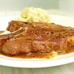 Juicy pork steaks with wine and honey